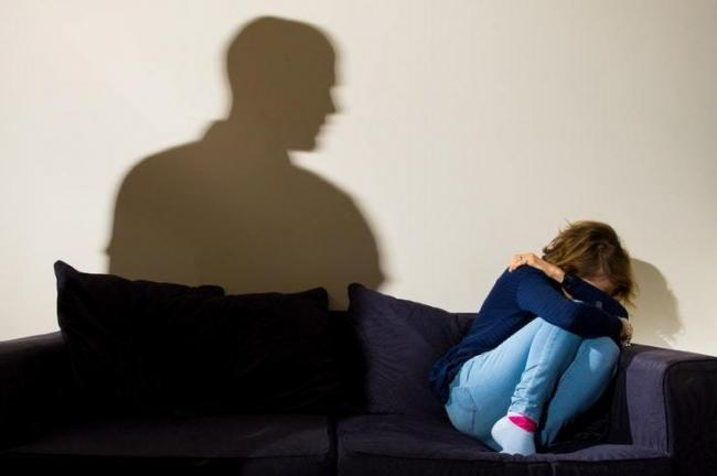 A female victim of domestic abuse. Picture: PA