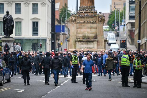 Demonstrators from the Loyalist Defence League and counter-groups clashed on Sunday