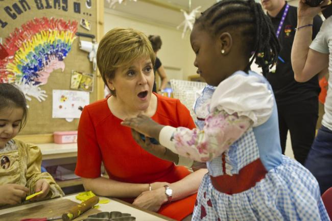 Nicola Sturgeon met some of the children at the Butterfly Nursery in Arden, Glasgow, who were among the first recipients of the doubling of free childcare Picture: John Gunion/PA Wire