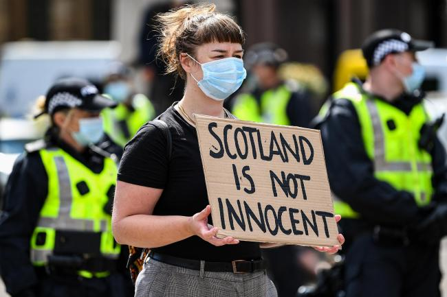 People participate in a Black Lives Matter demonstration in George Square