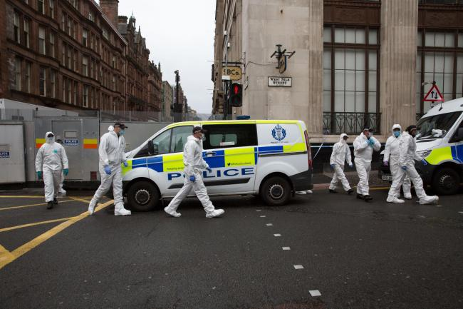 Police forensics officers leave the cordon at the same time as Positive Action on Housing hold a press conference on West George Street, Glasgow with Andrew from Biafra. He was a resident at the Park Inn hotel...Picture Robert Perry  29th June 2020..Must