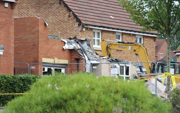 Glasgow Times: The house in Ewart Drive partially collapsed after the fire (Image: PA)