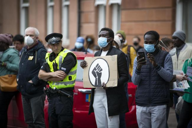 Activists from Stand Up to Racism hold a demonstration outside the Home Office's Glasgow Immigration Enforcement Reporting Centre to demand change and the end of hotel detention of refugees, following the incident on Friday June 26 at Glasgow's Pa