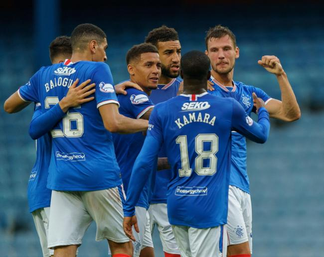 Borna Barisic of Rangers celebrates with team mates after scoring to give them a 1-0 lead from a free-kick during the Scottish Premiership match at Ibrox Stadium, Glasgow. PA Photo. Picture date: Wednesday August 12, 2020. See PA story SOCCER Rangers. Pho