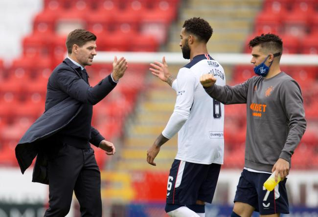 Rangers manager Steven Gerrard (left) shakes hands with Connor Goldson after the Ladbrokes Scottish Premiership match at Pittodrie