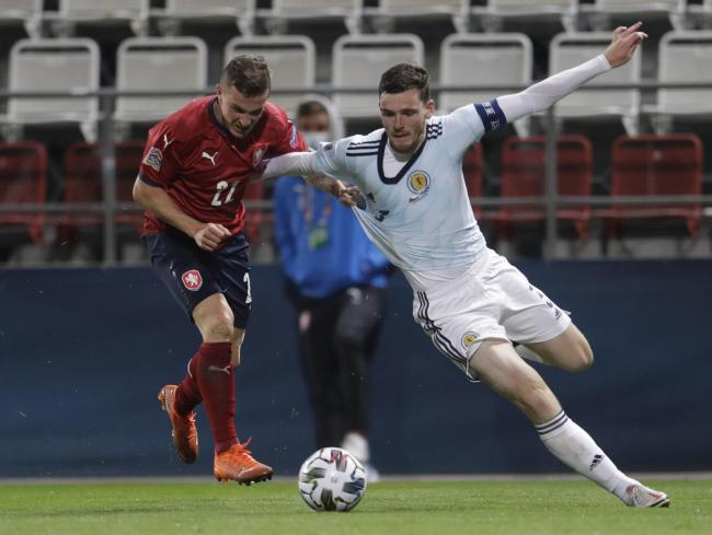 Andy Robertson is brought down for Scotland's penalty in the win over the Czech Republic.