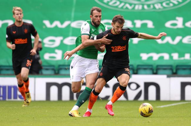 Hibernian's Christian Doidge (left) and Rangers' Borna Barisic battle for the ball during the Scottish Premiership match at Easter Road
