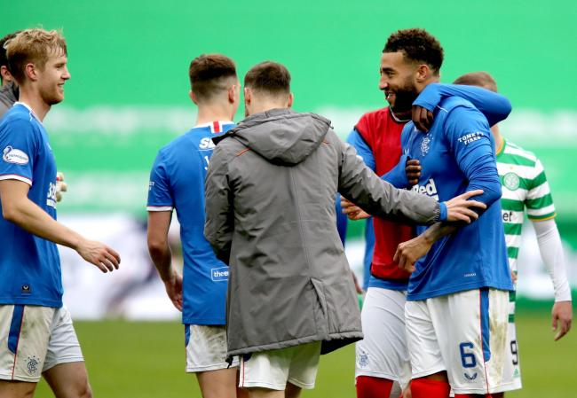 Rangers' Connor Goldson (right) celebrates with his teammates at the end of the Scottish Premiership match at Celtic Park