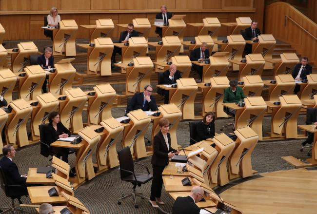 First Minister Nicola Sturgeon in the Scottish Parliament at Holyrood in Edinburgh, delivering a First Minister's statement outlining further coronavirus restrictions for Scotland. PA Photo. Picture date: Wednesday October 7, 2020. See PA story HEALTH