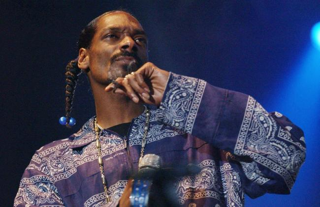 EDITORIAL USE ONLY. NO MERCHANDISING. American rapper Snoop Dog performs onstage, Tuesday 12 July 2005, at the Wembley Arena Pavilion, north London. PRESS ASSOCIATION Photo. Photo credit should read: Yui Mok/PA..