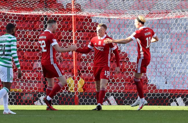 Lewis Ferguson, centre, celebrates after scoring Aberdeen's first goal against Celtic. Photo by Jeff Holmes/PA Wire.