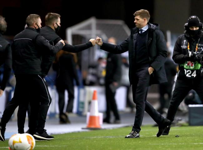 Rangers manager Steven Gerrard (right) fist bumps with members of staff at the end of the UEFA Europa League match at Ibrox