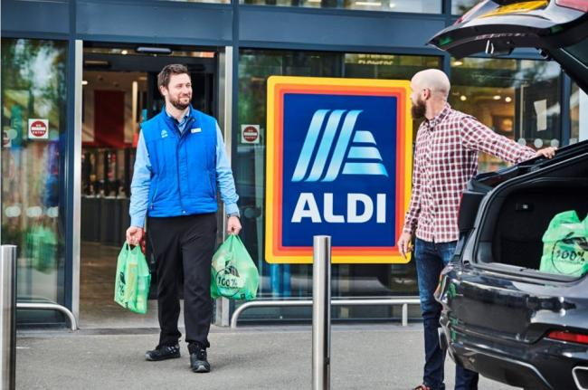 Man carrying shopping out of Aldi