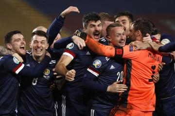 Calf tear was a small price to pay for Scotland coach John Carver amid scenes of celebration in Serbia