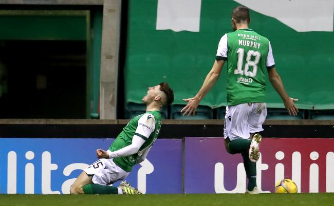 Hibernian's Kevin Nisbet, left, celebrates scoring his side's second goal against Celtic. Photo: Andrew Milligan/PA Wire.