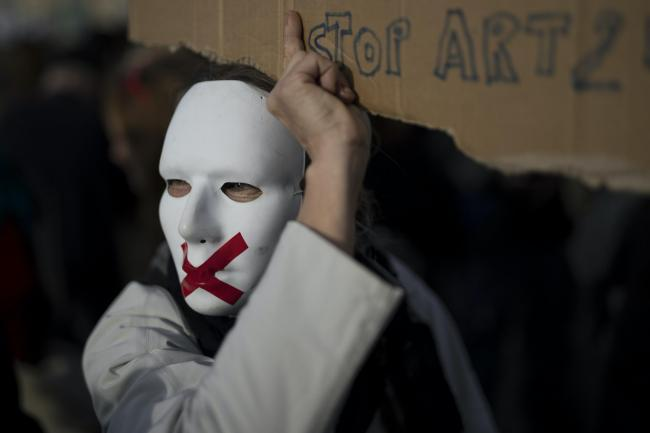 A protester in a mask