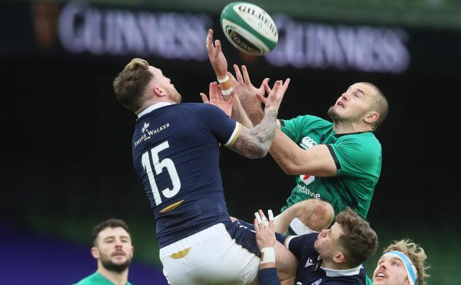 DUBLIN, IRELAND - DECEMBER 05: Stuart Hogg of Scotland (L) challenges for the high ball with Jacob Stockdale of Ireland (R) during the Autumn Nations Cup match between Ireland and Scotland at Aviva Stadium on December 05, 2020 in Dublin, Ireland. Sporting