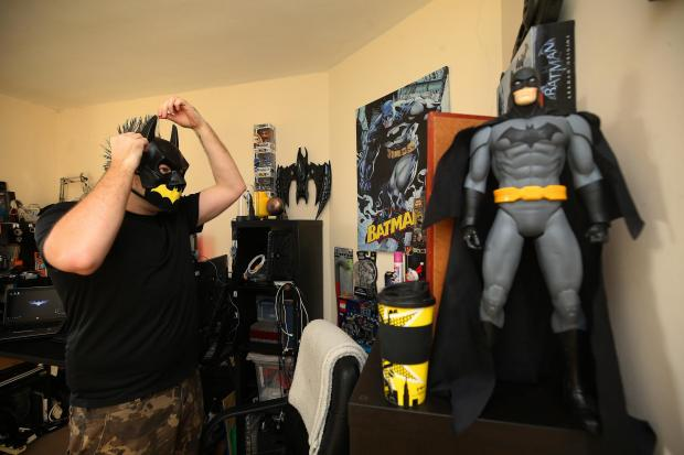 Glasgow Times: Batman superfan George Howie in his Paisley batcave Picture: Gordon Terris