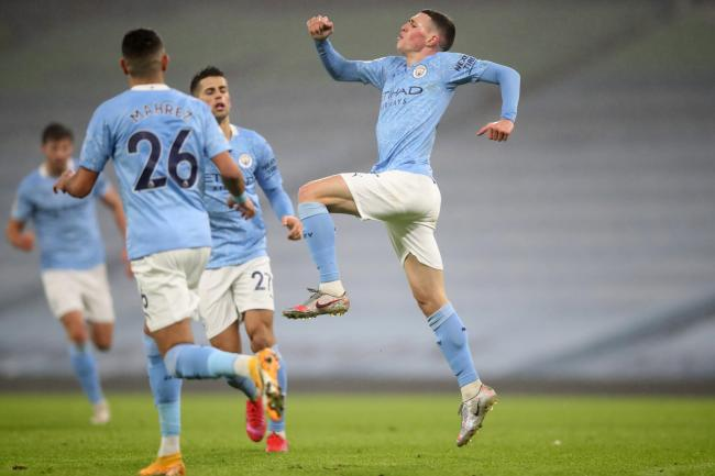 Phil Foden fired Manchester City to victory over Brighton