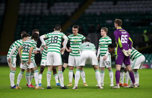 Celtic players in a socially distance Huddle before the Hibernian match. Photo by Ian MacNicol/Getty Images.