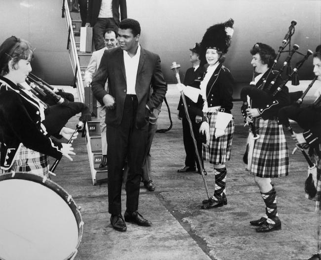 Cassius Clay arrives to the strains of the Braemar Ladies Pipe Band