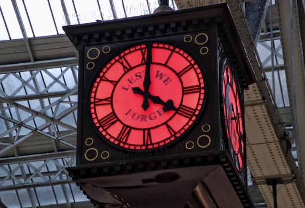 The Glasgow Central clock, lit up here in red by Poppy Scotland.