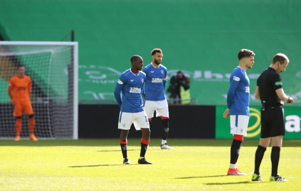 Glasgow Times: Glen Kamara (l) and team mates take a stand pre match rather than taking a knee before the Ladbrokes Scottish Premiership match between Celtic and Rangers at Celtic Park