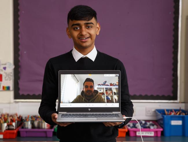 Awish Ul Haq pictured with his MCR Pathways mentor John Campbell during a video meeting  Picture: Colin Mearns
