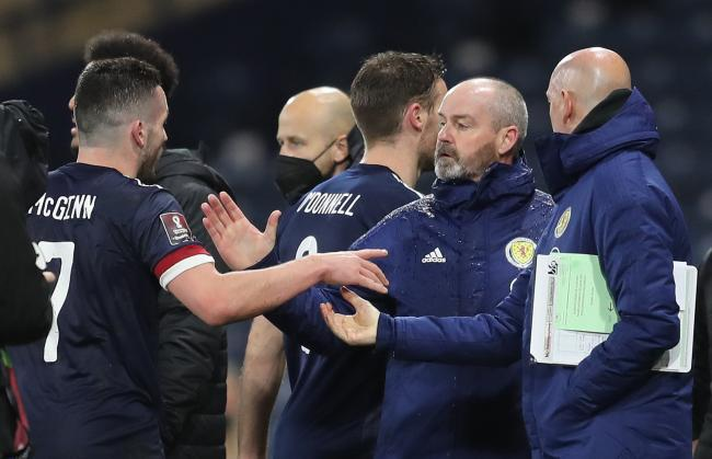 Scotland manager Steve Clarke, right, congratulates John McGinn after the 2-2 draw with Austria.