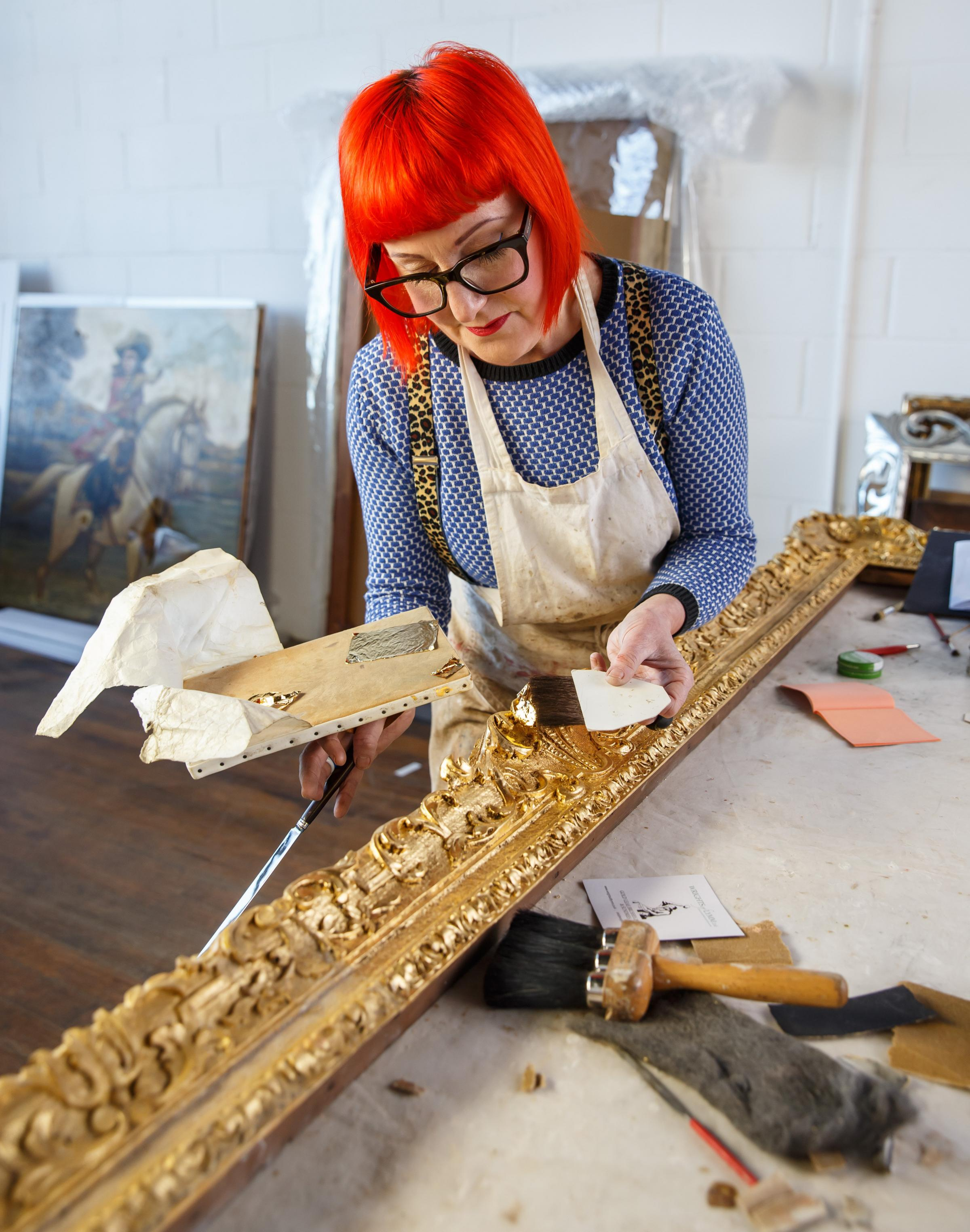 Sophie Kostin, frame restorer pictured at work on restoring a picture frame in her studio in Glasgow... Photograph by Colin Mearns.16 March 2021.For GT, see interview by Ann Fotheringham..