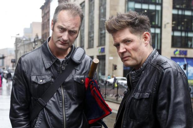 (L-R) Orde Meikle and Stuart Macmillan who perform as DJ Slam from Soma Records pose for a picture August 11, 2011 in Glasgow. (Photo by Mark Mainz).