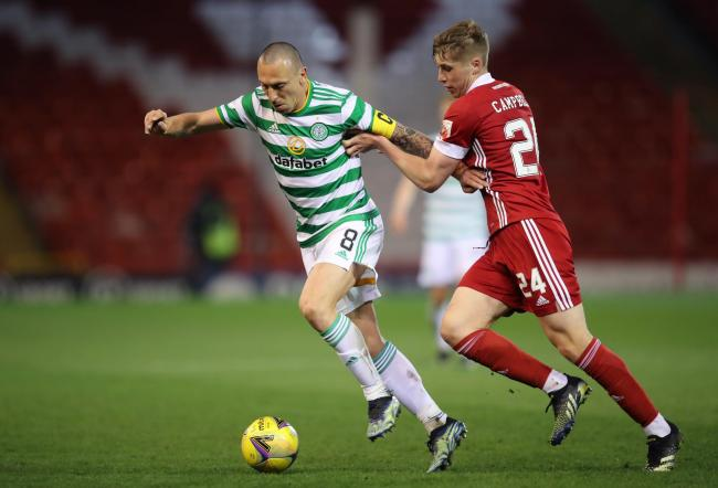 Celtic captain Scott Brown, left, in action against Dean Campbell of Aberdeen at Pittodrie last night.