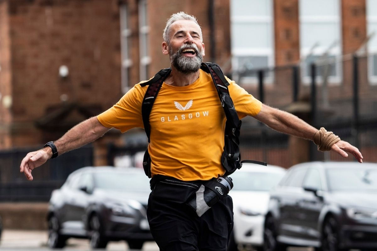 Rangers fan arrives back at Ibrox Stadium after charity challenge to Liverpool's Anfield