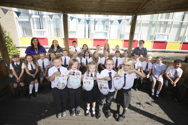 Glasgow Times: Head teacher Geraldine Miller, left, with St. Paul's School students when they received the Rights Receiving School Gold Accreditation Photo: Gordon Terrace