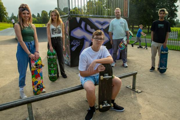 Glasgow Times: East Renfrewshire freelance David McDonald (fourth from left) with skateboarders at Roken Glenn Skateboard Park.  Pictured on the left are Charlotte Waugh, 16, Anna Johnston, 17, Harris McConnell, 15, and Yousef Asghar, 19. [Photograph by Colin Mearns]