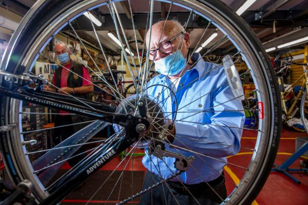 Glasgow Times: Veteran Alan Kennedy participates in the 'Build Your Bike' project. [Image: Erskine]