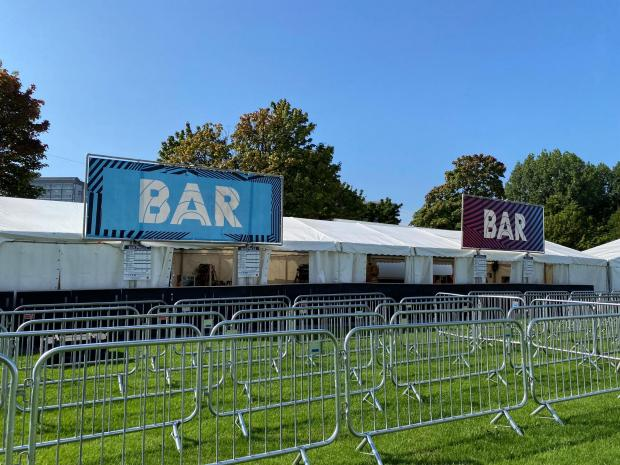 Glasgow Times: A bar area with barriers at the TRNSMT Festival site.