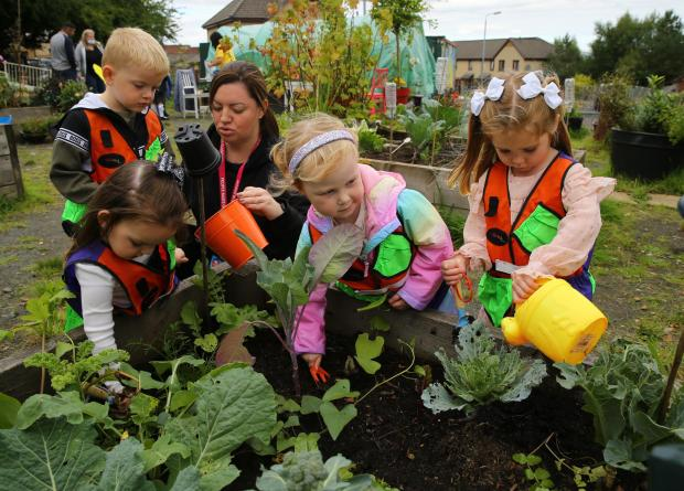Glasgow Times: Streets forward feature on Lockheed community allotment at Glasgow's Easter House.  Photo courtesy of Sarah Hendry, Child Development Officer at St. Clair Day Nursery, left from Brody, Ava, Aria and Zoo.  They are taking care of their upbringing.