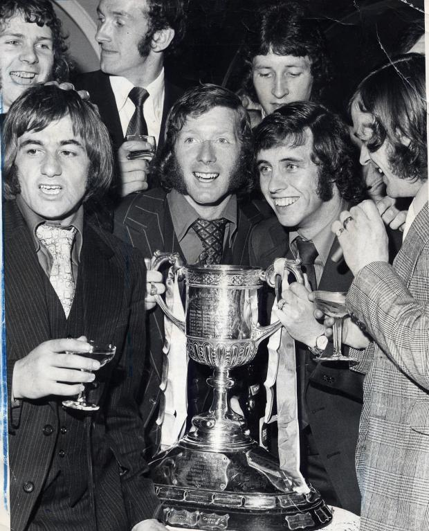 Glasgow Times: Rangers players celebrate with the Scottish Cup in January 1974.  The players are in the back row.  LR ALFIE CONN, PETER MCLOY, DEREK PARLANE.  Front LR, Quentin Young, Alec MacDonald, Tommy McLean and Willie Matheson.  Photo news.