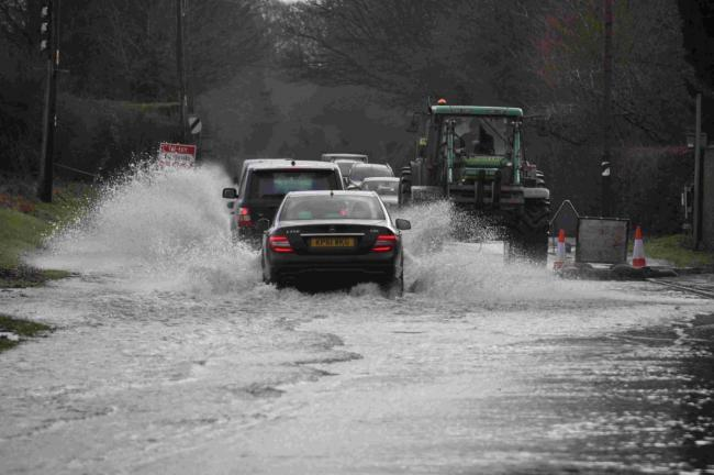Torrential rain prompts warning to drivers as flooding forces road closure