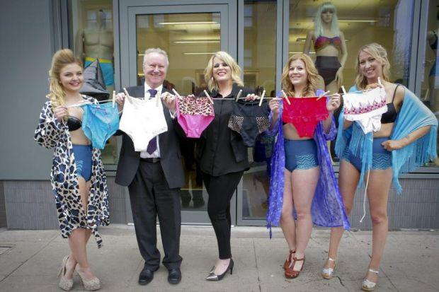 Nicola Dames, centre, with Alex Neil and models  at the launch of her Vanilla Blush lingerie range