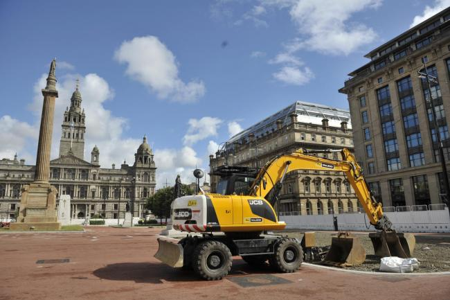 New grey resin being applied to the surface of George Square as part of the refurbishment before the Commonwealth Games.