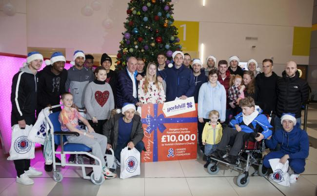 Rangers players and manager Mark Warburton visit children Ross Ferry, Billie Jean, Alison McNabb, Ciara Allan, Aaron McGurl, Poppy Williamson and Max Reid at the Royal Hospital for children in Glasgow.