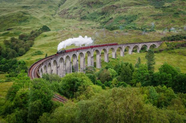 Glasgow Times: View of a steam train on a famous Glenfinnan viaduct, Scotland; Shutterstock ID 154641122; PO: THE HERALD MAGAZINE ; Job: TRAVEL