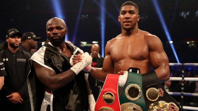 Joshua defends referee's stoppage as he retains titles with win over Takam