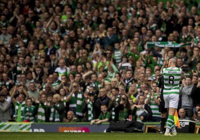 Celtic's Scott Brown applauds the fans.