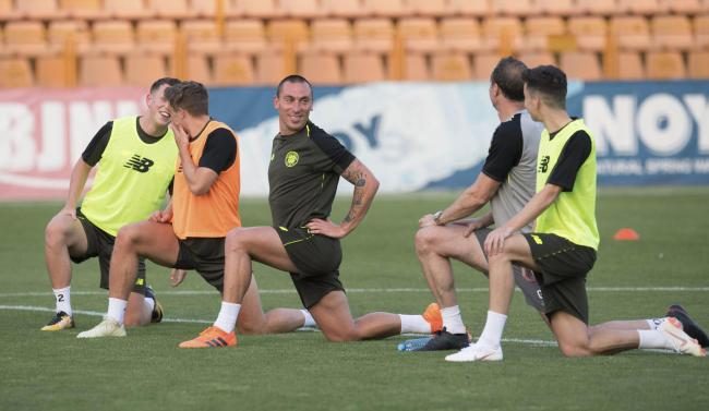 Callum McGregor and James Forrest share a joke with Scott Brown as Celtic train in Yerevan last night