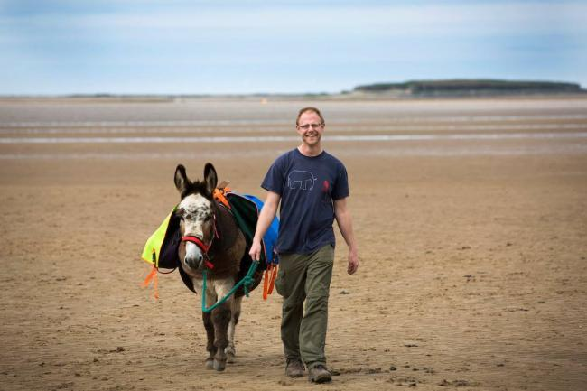Adam Lee with Martin the Donkey. Credit: Colin McPherson