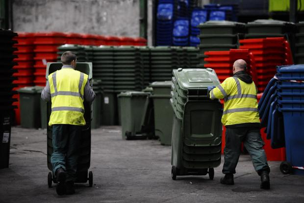Glasgow Times: GLASGOW, SCOTLAND - OCTOBER 13: a general view of green wheelie bins at Blochairn recycling facility on October 12, 2017 in Glasgow, Scotland.  Glasgow City Council are next week starting a programme of replacing old metal bins in the city with new green