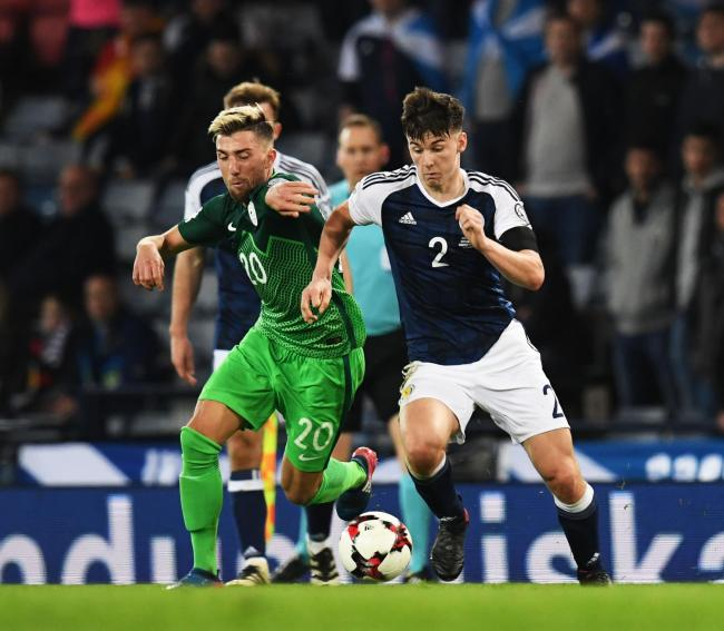 26/03/17 FIFA WORLD CUP QUALIFYING . SCOTLAND v SLOVENIA (1-0) . HAMPDEN PARK - GLASGOW . Scotland's Kieran Tierney (R) and Slovenia's Kevin Kampl battle for the ball.